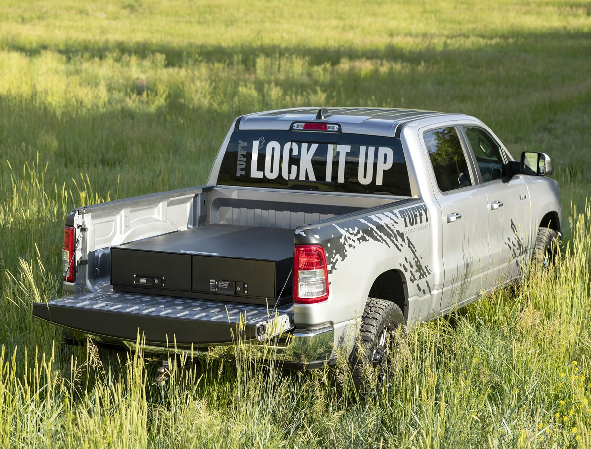 Tuffy security products truck in a tall grass field