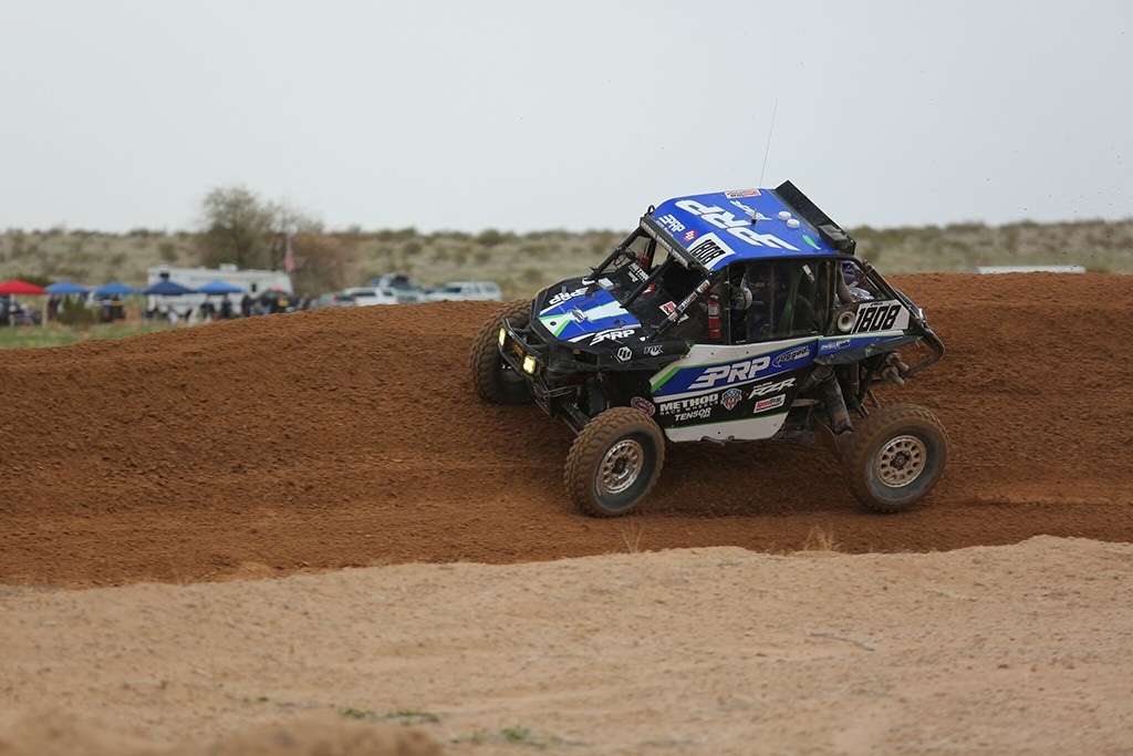 PRP RZR making the turn on a dirt course